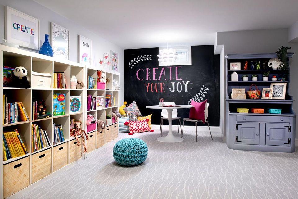 Interior designer Tess Leeds helped turn a Newton play area into a stylish space with lots of storage for toys, a pillow corner for reading and lounging and a chalkboard wall to be enjoyed by all ages.