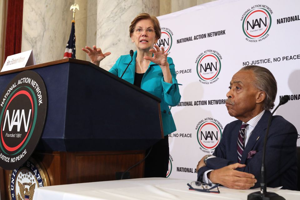 The Rev. Al Sharpton listened to Senator Elizabeth Warren last month. Sharpton says he was surprised by her ability to connect with black voters with her words and actions.