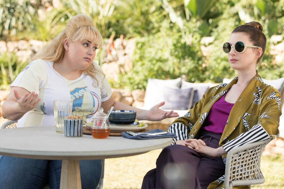 """Rebel Wilson (left) and Anne Hathaway in """"The Hustle."""""""