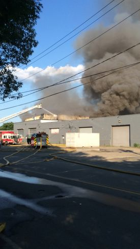 A four-alarm fire broke out at a Brockton recycling center on Saturday.