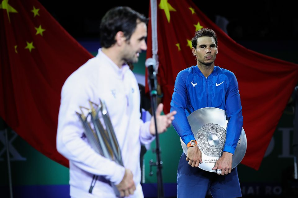 Rafael Nadal (right) looks on as Roger Federer addresses the crowd after the finale in Shanghai.