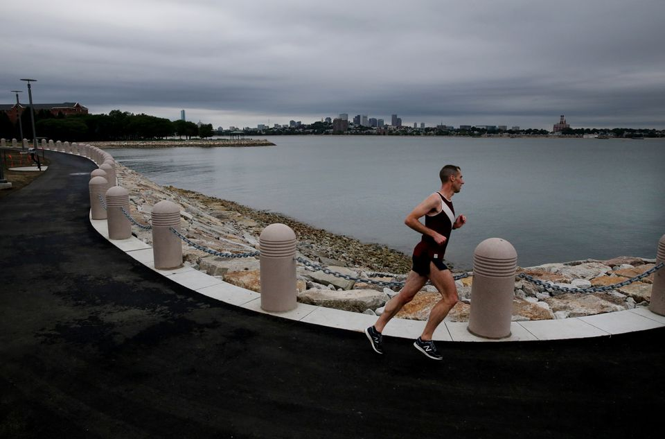 A runner used the newly opened section of the Harborwalk at UMass Boston on July 18.