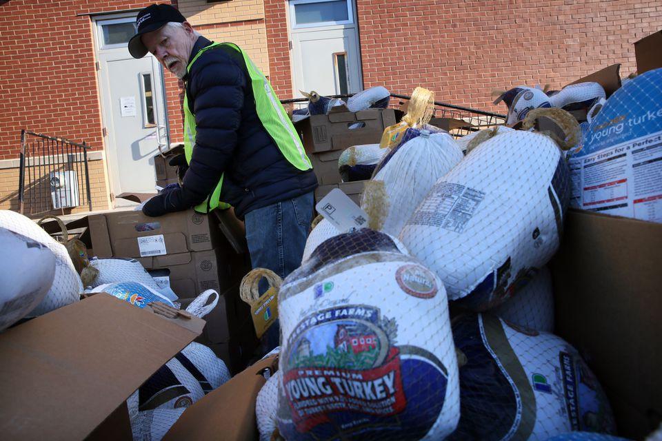 Volunteer Fred Plett unpacked turkeys Saturday.