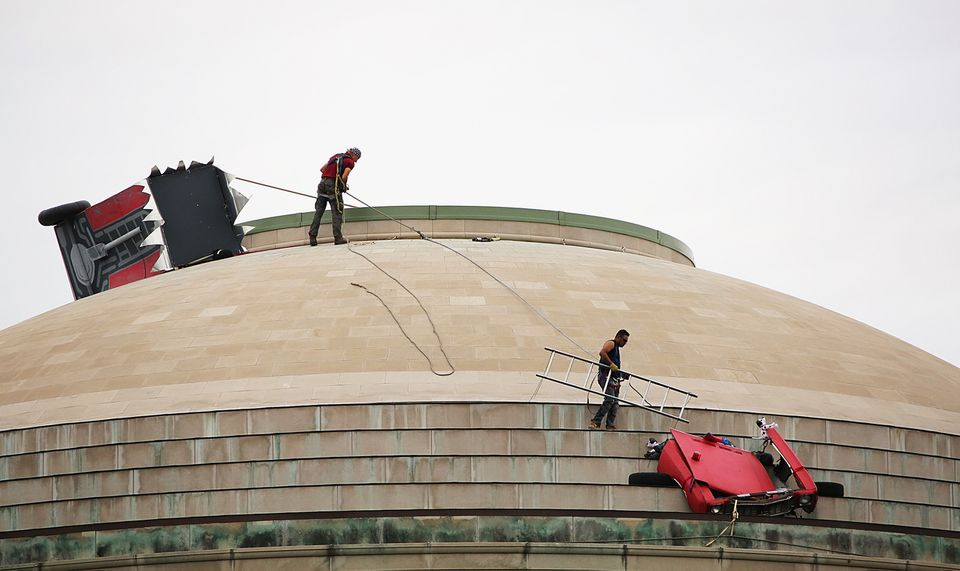 Workers removed a fire truck from MIT's Great Dome in September 2015.