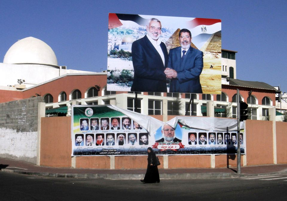 President Mohammed Morsi, at right in this Gaza City poster, is setting an independent course for Egypt.