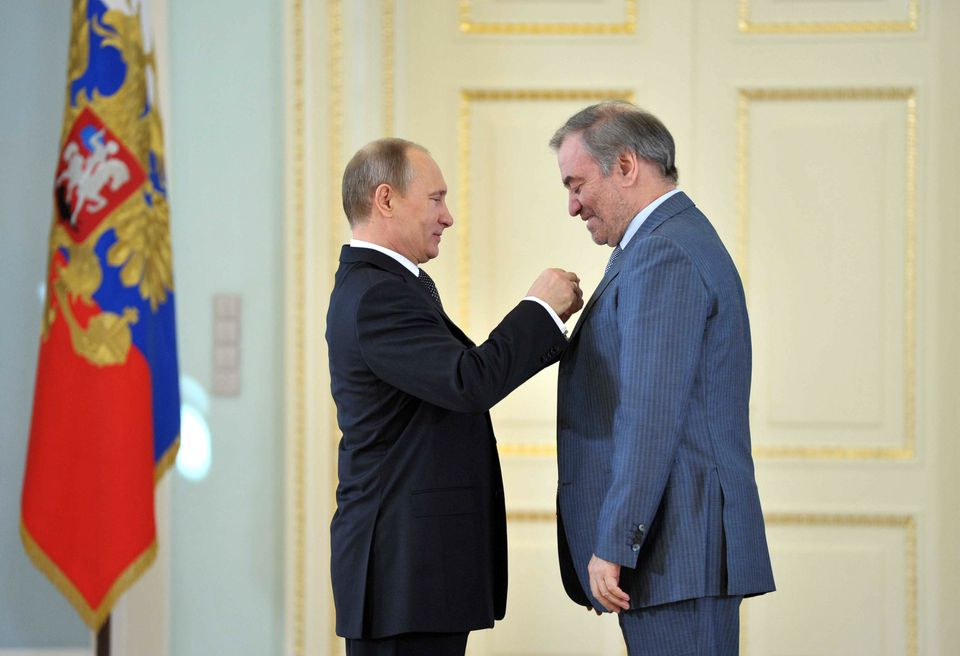 President Vladimir Putin (left) honored conductor Valery Gergiev with a Hero of Labour award during a ceremony in St. Petersburg.