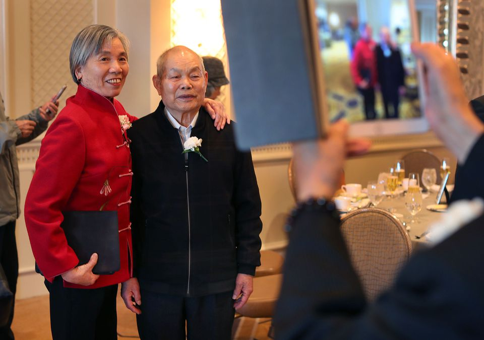 Ginsong Shu (left) and her husband Quixuang Wang, married 51 years, had their photo taken by a friend at their table.