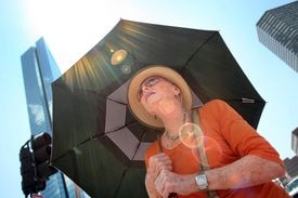 Jeanette Newman from Boston is trying to limit her exposure to the sun.
