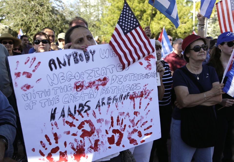 Sonia San Martin held a sign during a protest in Miami's Little Havana neighborhood on Dec. 20 against President Obama's plan to normalize US relations with Cuba.