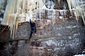 A climber ascends a ''mixed climb,'' which requires using tools to hook tiny rock edges.