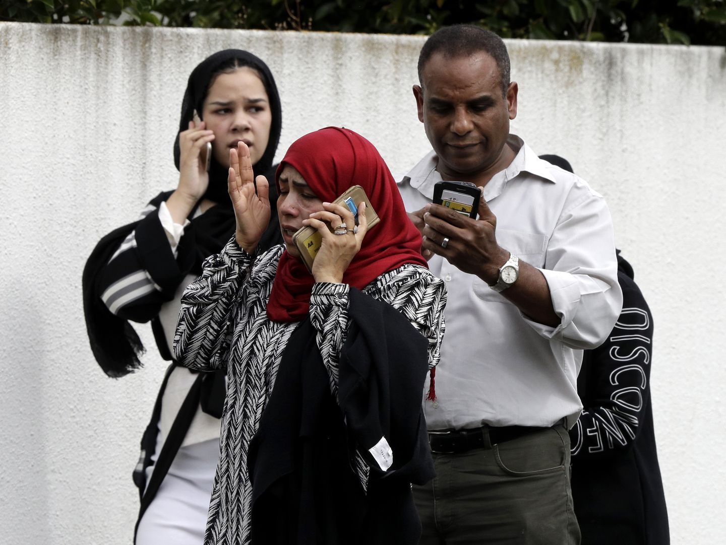 People waited outside a mosque in central Christchurch.