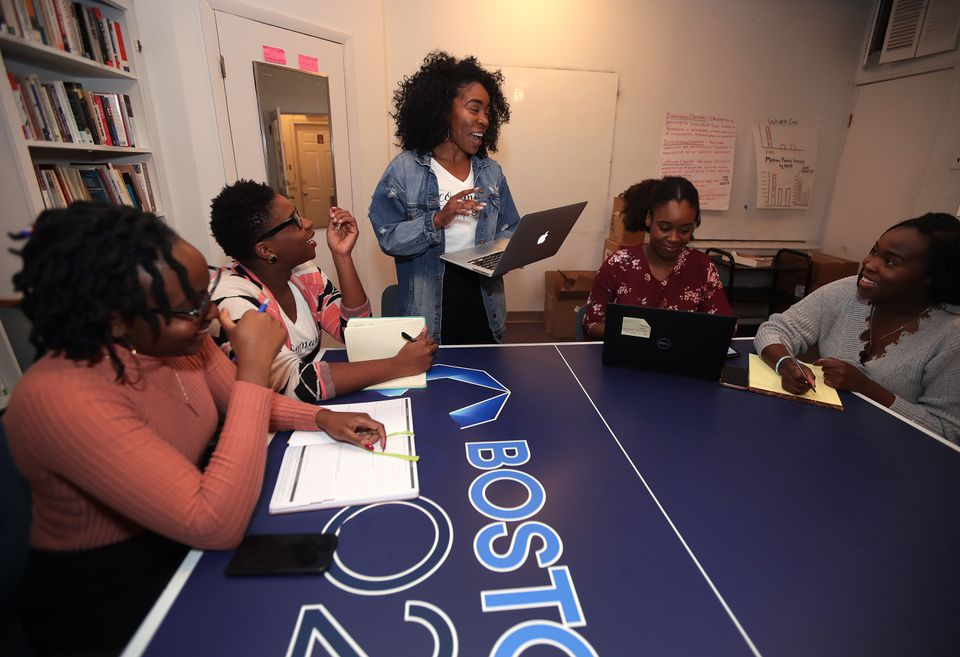 Jessicah Pierre (standing), founder of Queens Co., worked out details of the sold-out Queens Dinner scheduled for Saturday night at District Hall in the Seaport.