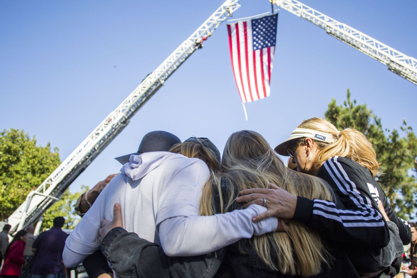 Friends hugged outside Los Robles Medical Center in Thousands Oaks, California, paying tribute to Ventura Country Sheriff's Sgt Ron Helus.