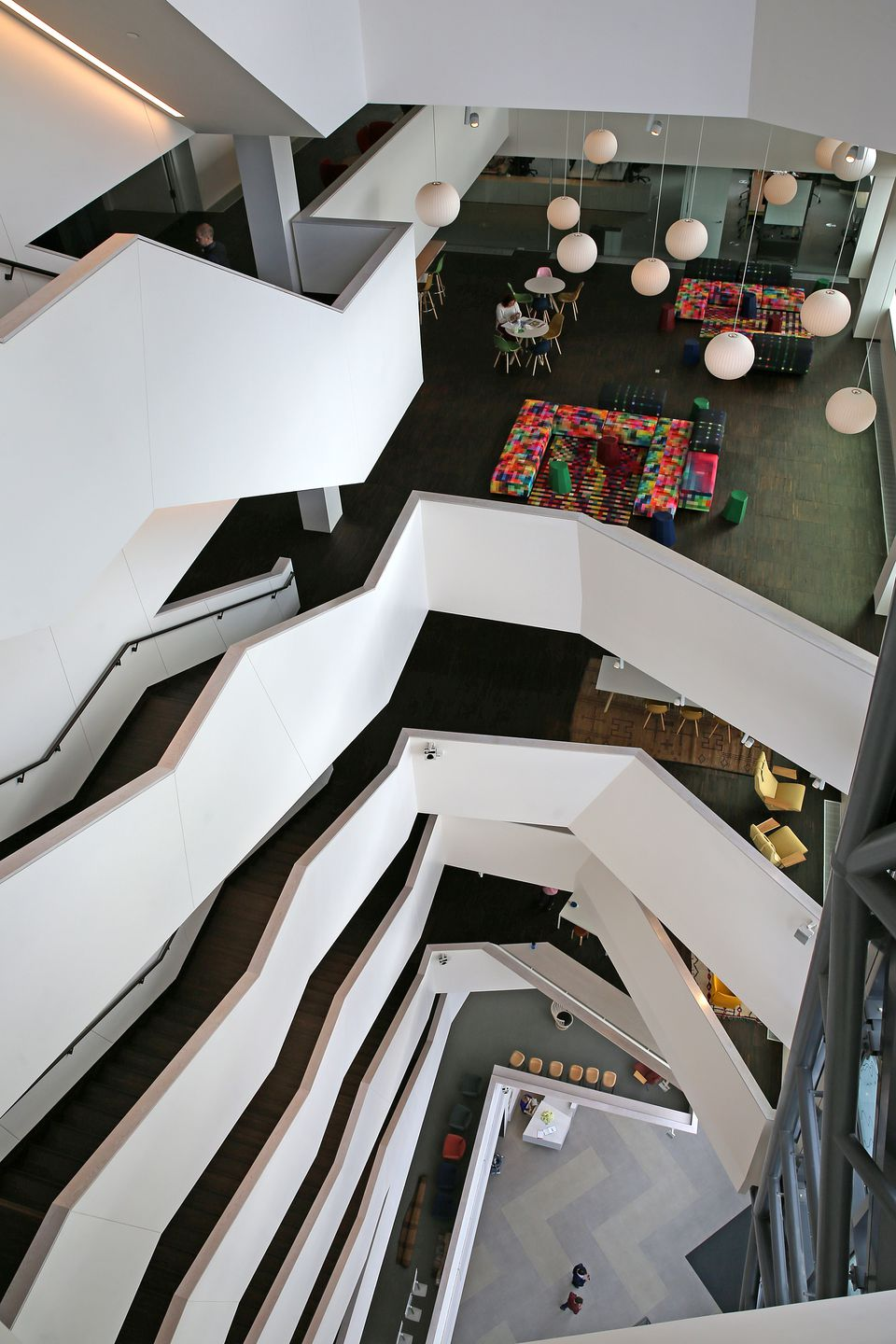 The building features an open staircase that serves all 10 floors and a glass-clad exterior.