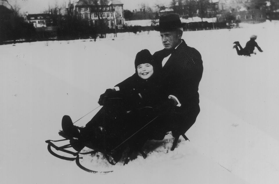 A young Rosemary sleds with her godfather, Eddie Moore.
