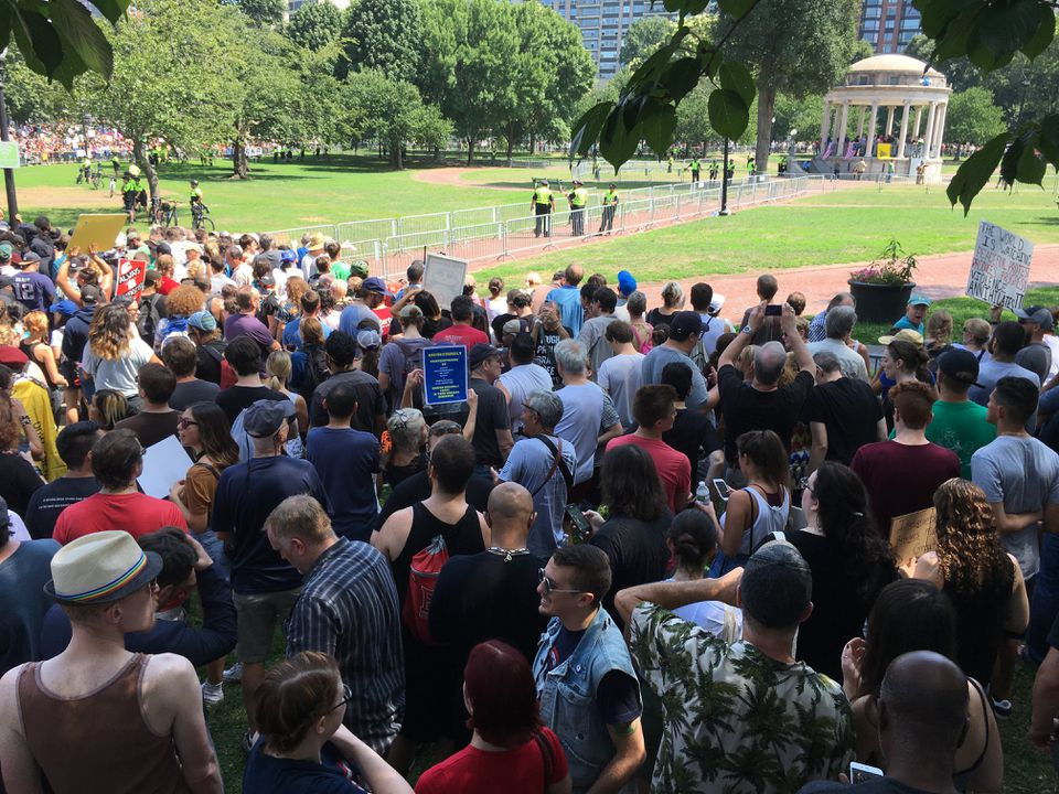 "Counterprotesters looked toward the ""free speech rally"" at the Common's Parkman Bandstand."