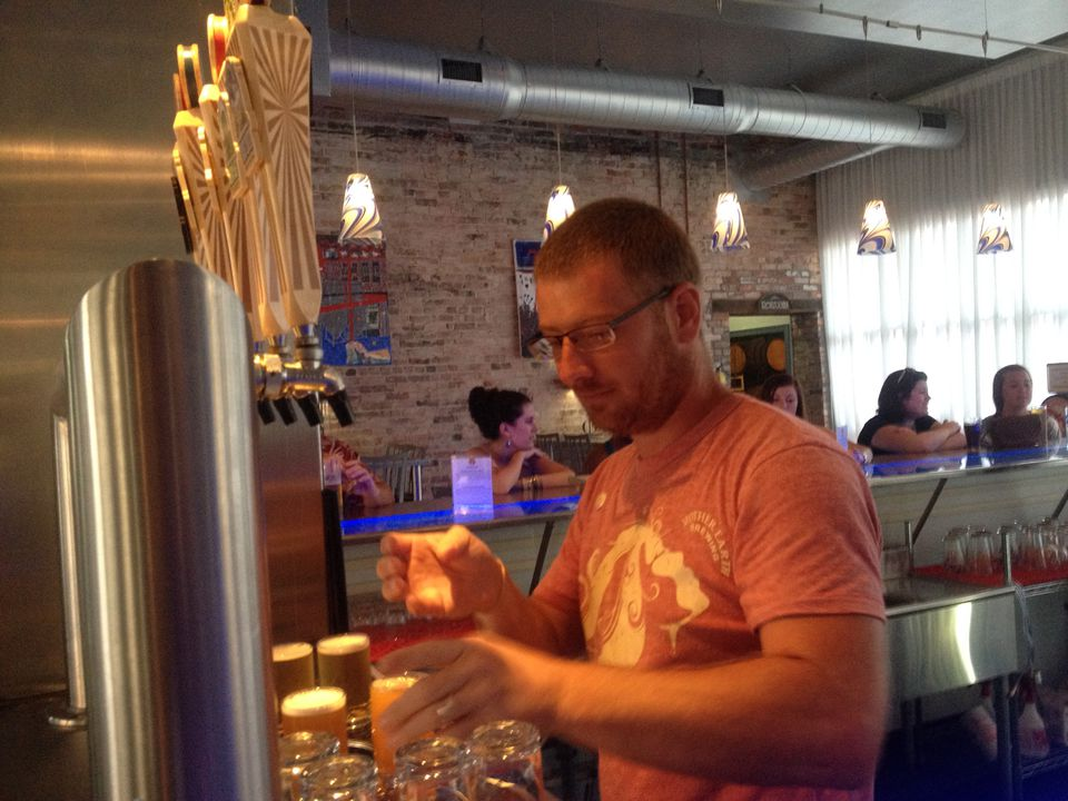 Marty Stancil fills beer orders at Mother Earth Brewing.