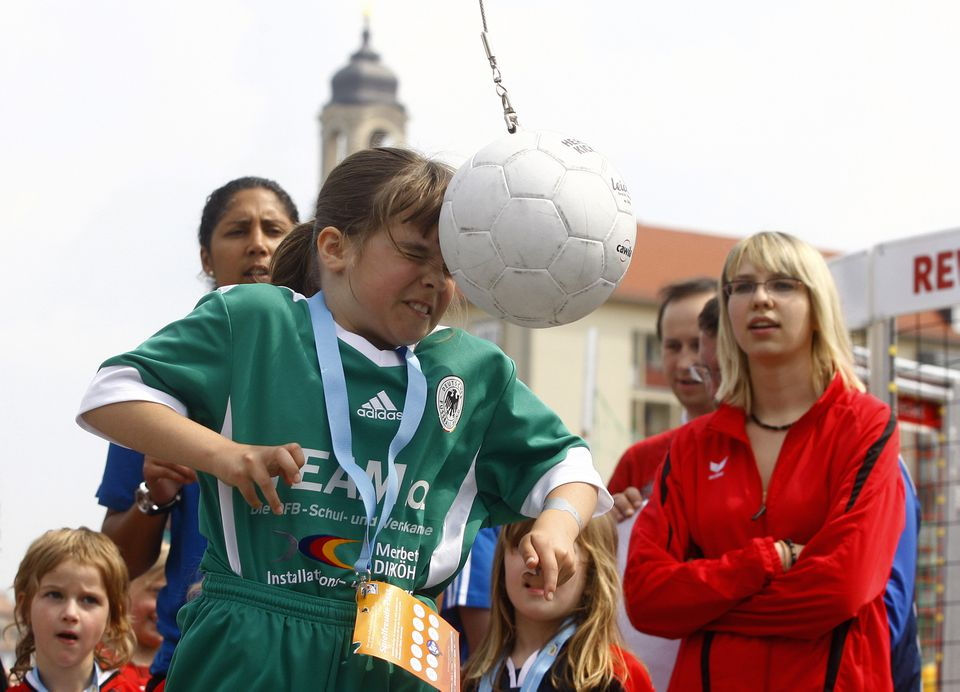 A young girl practices heading a ball during the FIFA U20 Women's World Cup 2010 road show in Dresden, Germany.