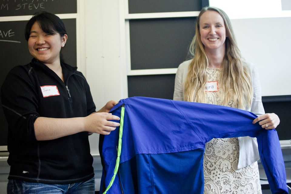 "June Kim (left) and Kira Bender presented their prototype ""RAYN Jacket,"" which they designed with Alexander Peacock (not pictured) specifically for Ryan DeRoche, who sustained injuries in a bicycle accident that make it difficult to get dressed."