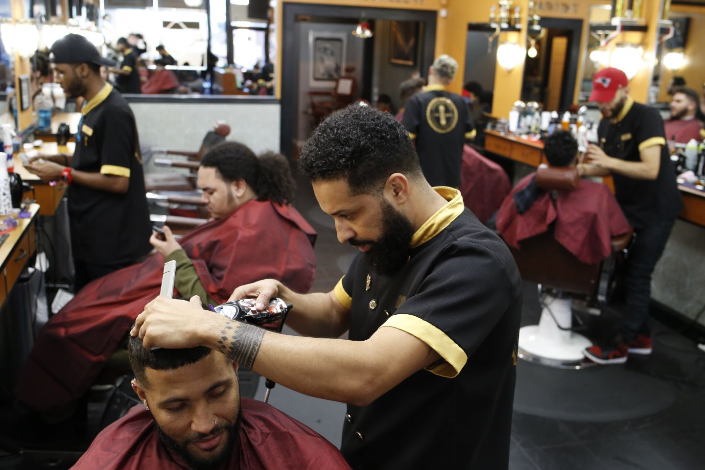 Lex Andre Daluz, owner of Marvelous Cuts, shaped up Amalex Veiga's hair.