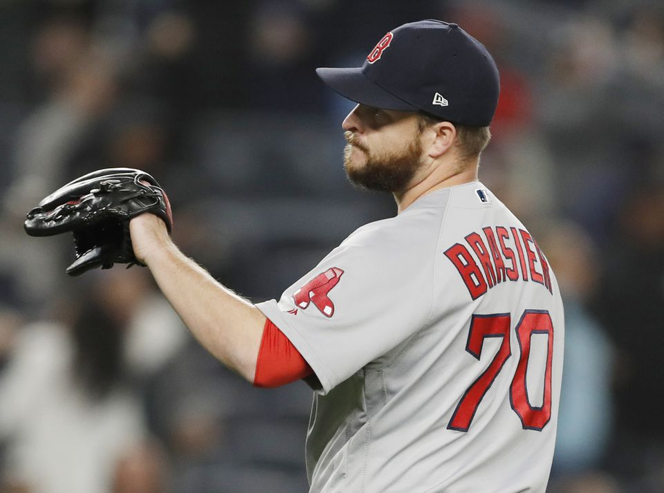 Red Sox reliever Ryan Brasier reacts with chagrin after allowing a seventh-inning, grand slam to New York's Brett Gardner in Wednesday night's 5-3 loss at Yankee Stadium.
