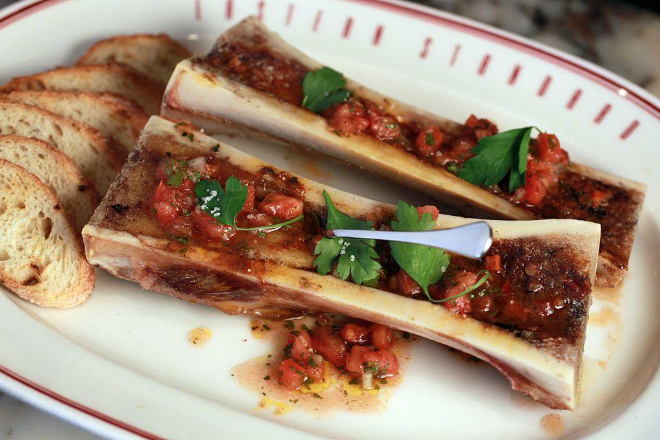 Roasted bone marrow with 'nduja marmalade and tomato vinaigrette.
