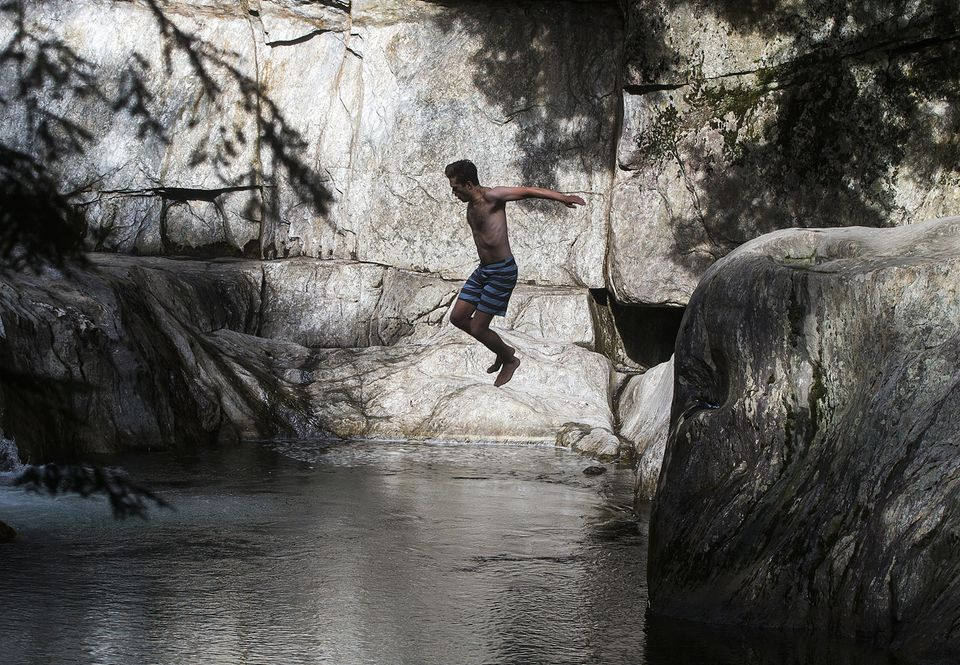 Going in feet-first at the Warren Falls swimming hole in Vermont.