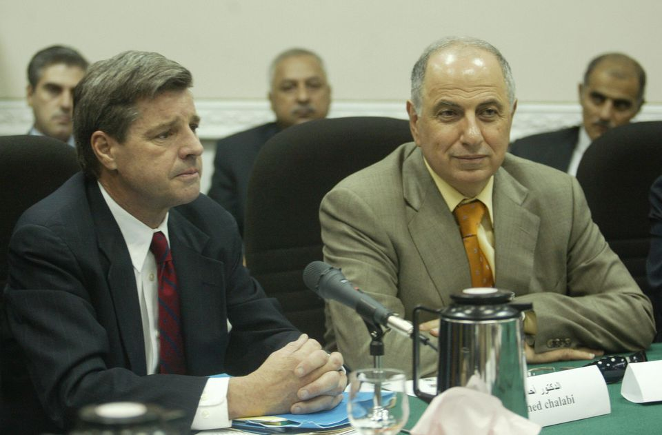 Bremer, pictured with Ahmad Chalabi in Baghdad in 2003, was leery of the Iraqi exile favored by many neoconservatives in the Bush administration. Chalabi, who was later accused of passing secrets to the Iranians, died last year.