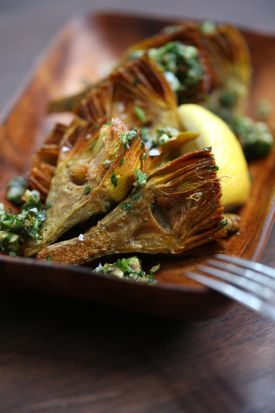 The braised artichokes starter includes anchovies and capers.