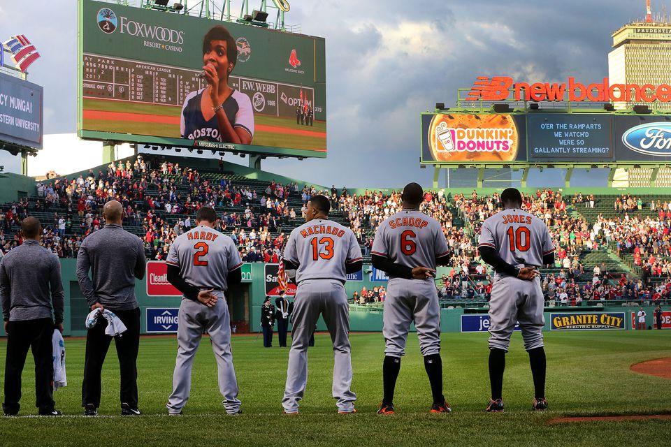 Players stood while a Kenyan woman sang the national anthem at Fenway Park on Tuesday.