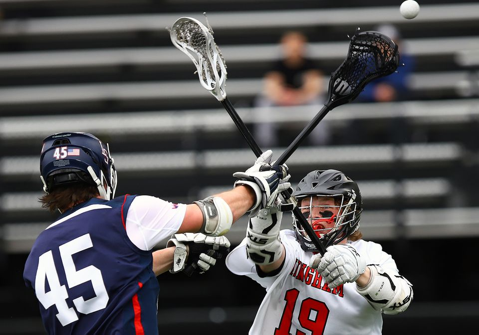 Hingham's Jonathan Bearden tries to stop a pass by Lincoln-Sudbury's Finn Garrity in Saturday's final of the Coaches Cup boys' lacrosse tourney at Winchester High.