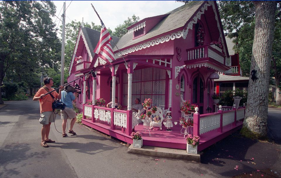 """The """"pink house"""" is supposedly the most photographed of the gingerbread houses on the Martha's Vineyard Camp Meeting Grounds. Here it's being photographed for the Travel Channel."""