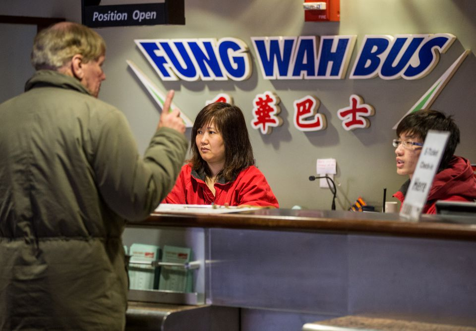 A worker at the Fung Wah counter at South Station sold tickets on Feb. 26, 2013.