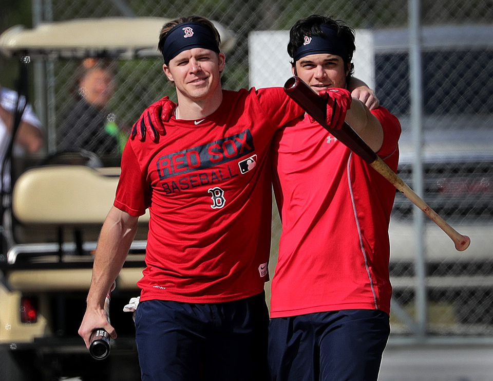 Brock Holt (left) played the most games in left field for the Red Sox in 2016. This year, Andrew Benintendi (right) is expected to hold that honor.