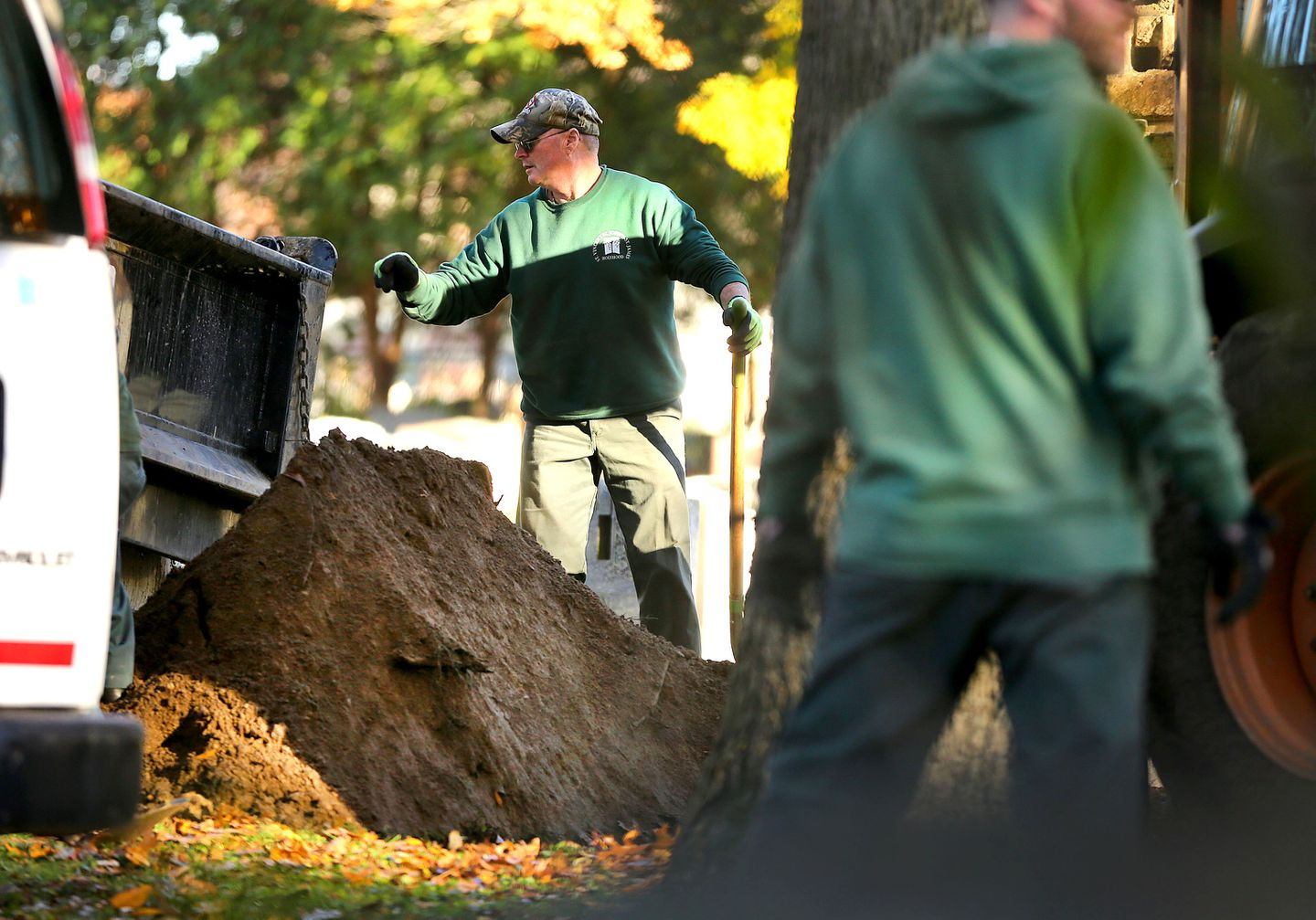 """Cemetery workers at St. Joseph's Cemetery put dirt on the burial site of James """"Whitey"""" Bulger."""