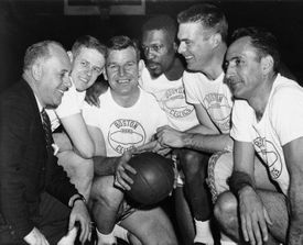 Mr. Loscutoff (holding ball) with (from left) Red Auerbach, Frank Ramsey, Bill Russell, Tommy Heinsohn, and Bob Cousy. Mr. Loscutoff was known for having his teammates' backs.