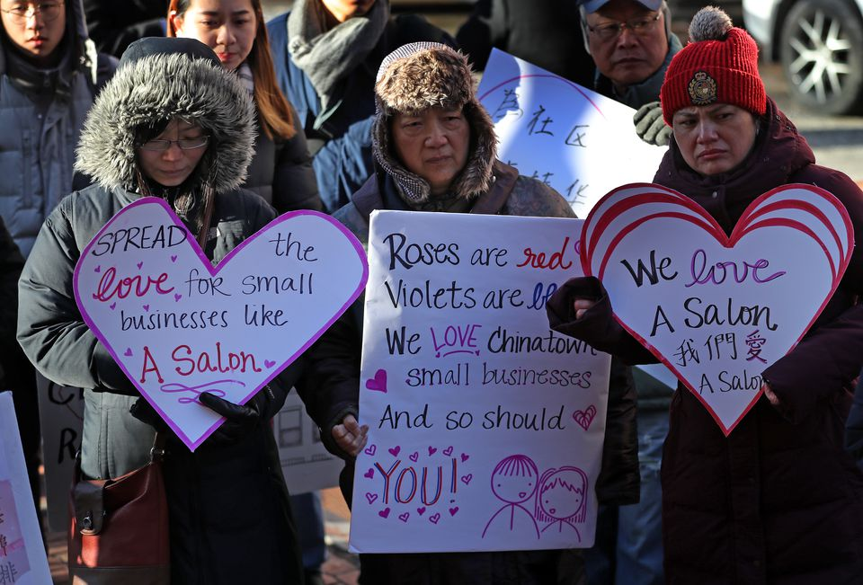 Supporters held heart shaped signs at a rally for Yan Chi Chen before he went to court on Feb. 14.
