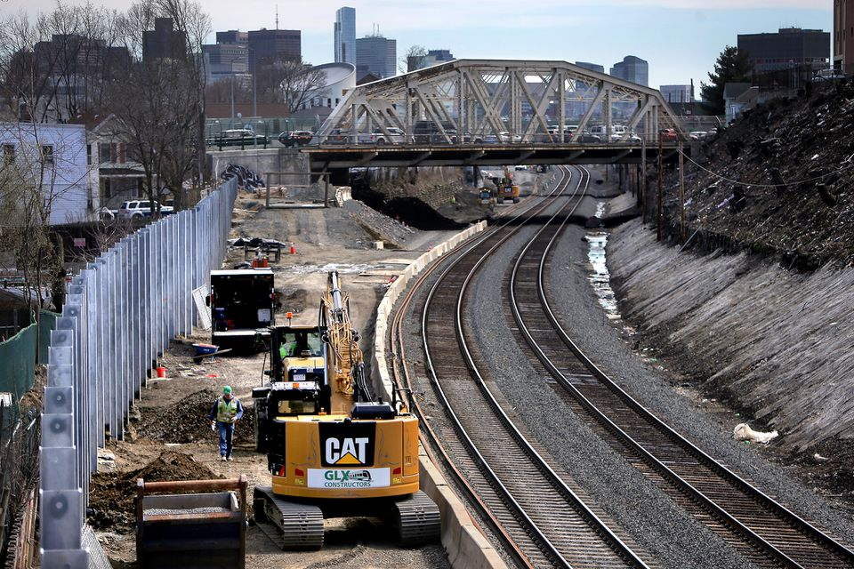 A noise barrier was under construction near Walnut Street in Somerville to shield residential buildings from future trolleys.