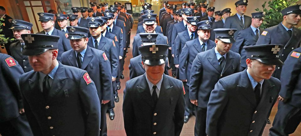 Firefighters were sworn in after graduating from the Boston Firefighting Academy.
