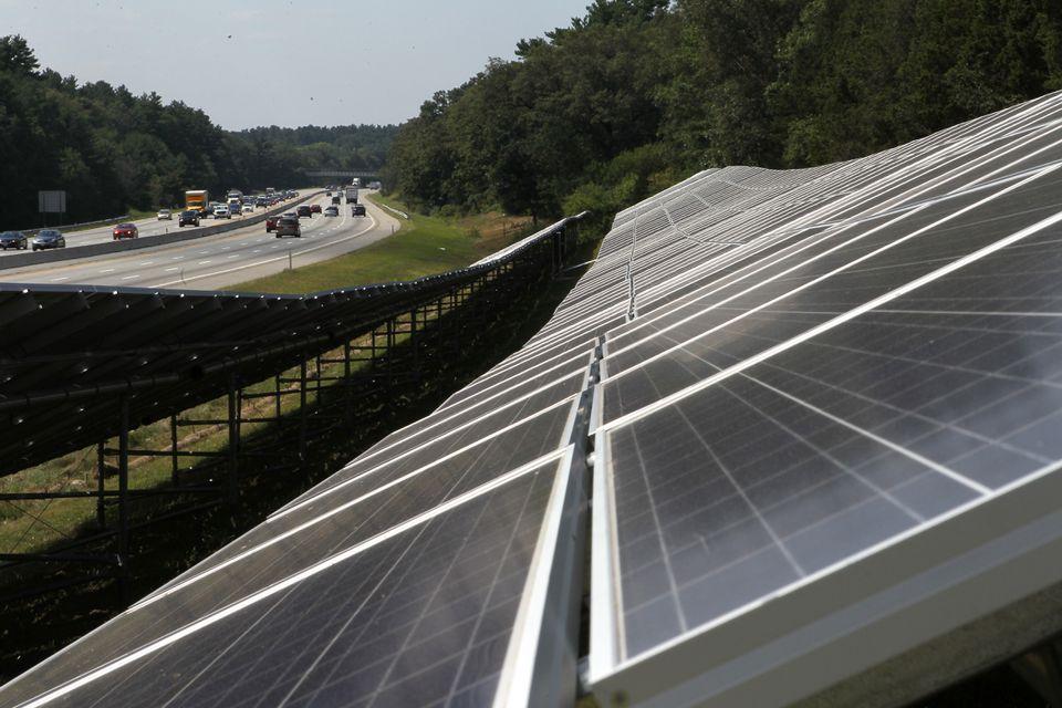 A solar panel farm along the Massachusetts Turnpike in Natick.