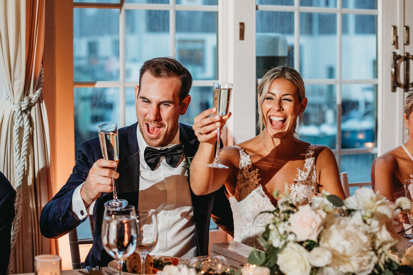 Newlyweds Jimmy and Kristen Hayes lift their glasses for a toast during their wedding reception last July.