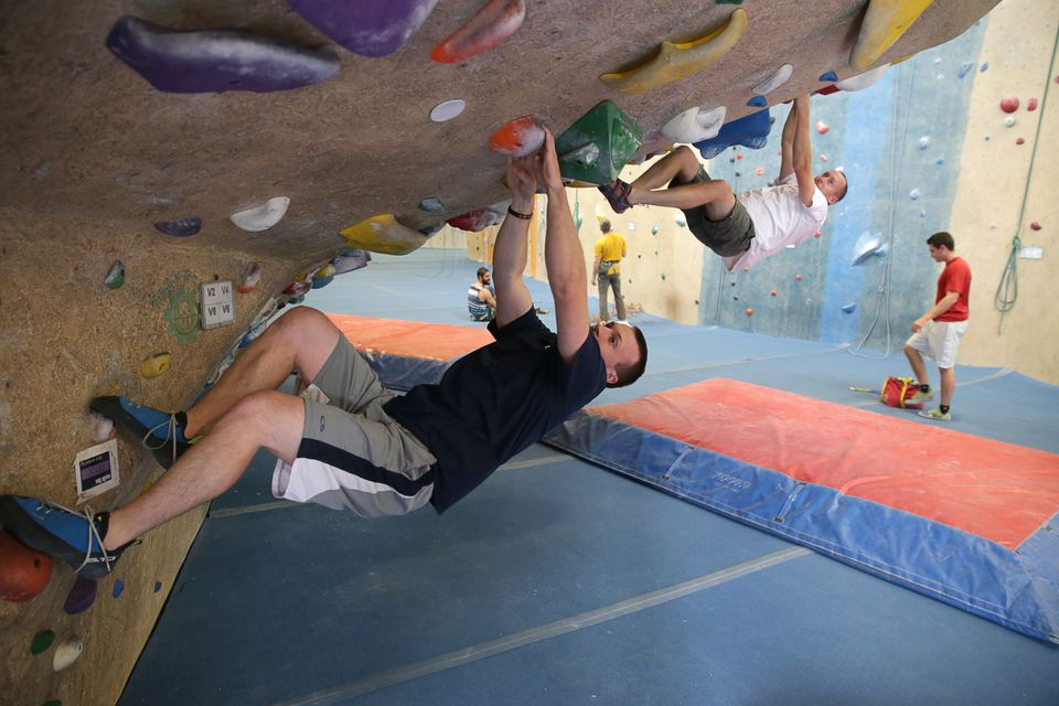 Employee Kurt Noelte spends time on the rock wall with co-workers at the Central Rock Gym. Cannistraro provides free membership to employees at the gym, which is located behind the Watertown headquarters.