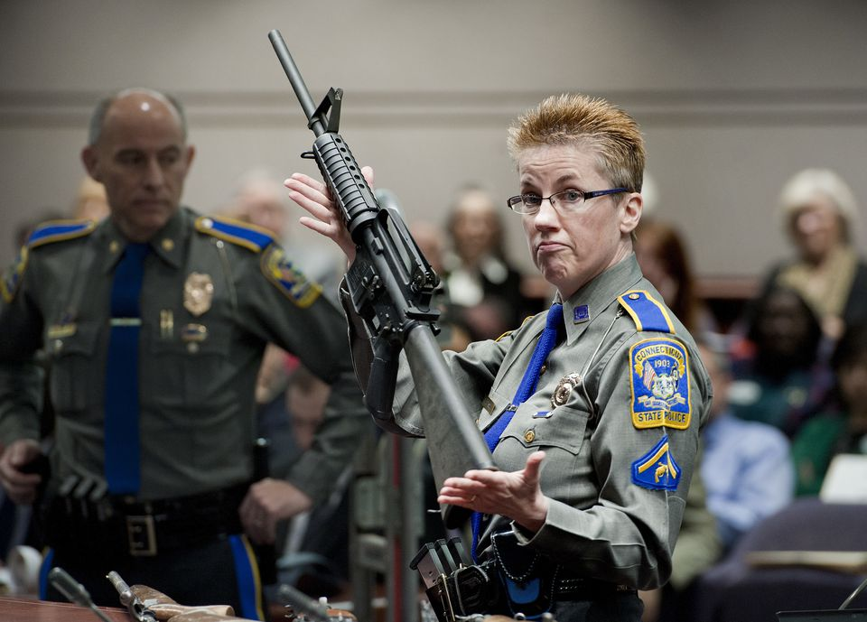 In this 2013 photo, Detective Barbara J. Mattson of the Connecticut State Police showed a Bushmaster AR-15 rifle, the same type used by Adam Lanza to kill 26 people in 2012 at Sandy Hook Elementary School.