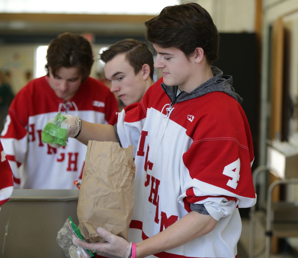 Hockey team member Jake Higgins and his teammates worked steadily through the end of the lunch period.