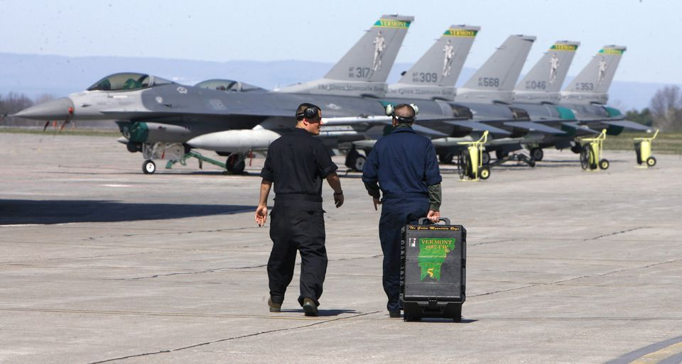 A maintenance crew walked toward a row of Vermont Air National Guard F-16 fighter jets in South Burlington, Vt., in April 2010.