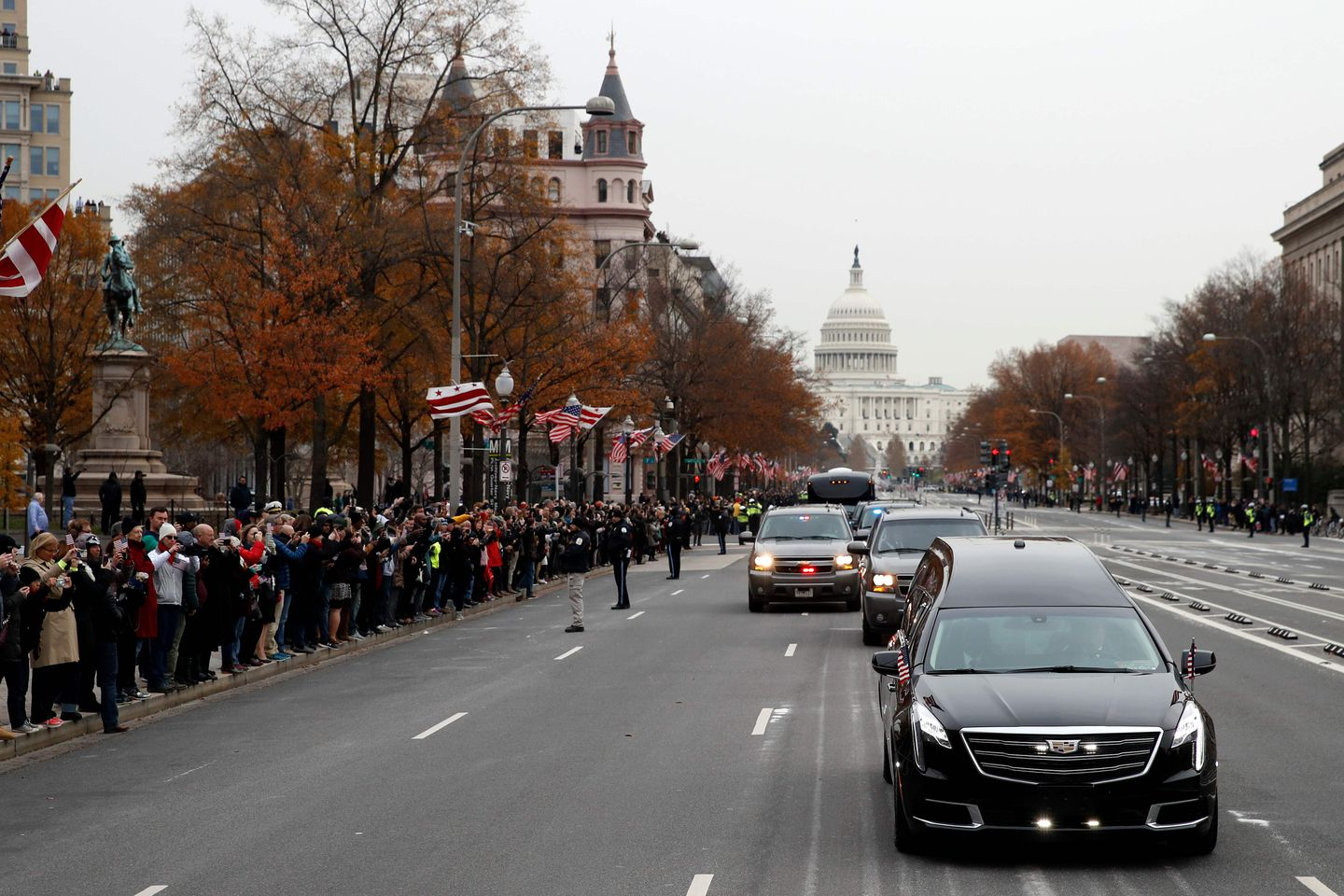 People lined Pennsylvania Avenue as the hearse passed by carrying the remains of former President George H.W. Bush.