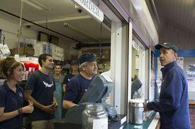 President Barack Obama (right ordered food at Nancy's restaurant in Oak Bluffs in 2013.