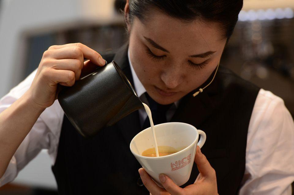 Ogawa Coffee's Hisako Yoshikawa competes at the 2013 World Latte Art Competition, which she ultimately won.