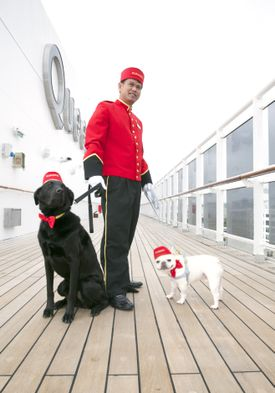 Kennel master Oliver Cruz and friends aboard the Queen Mary 2.