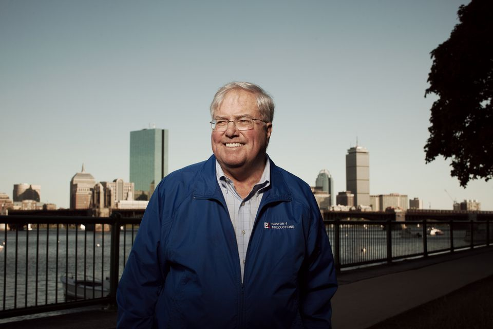 """In the best possible way, I think of David as a big kid whose absolute favorite holiday in the entire world is the Fourth of July,"" Pops conductor Keith Lockhart says of David Mugar, shown in Cambridge overlooking the skyline of the city he loves."
